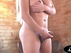 Curvy blonde shemale solo wanks her pecker