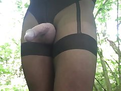 Black Crotchless suspender tights in the woods